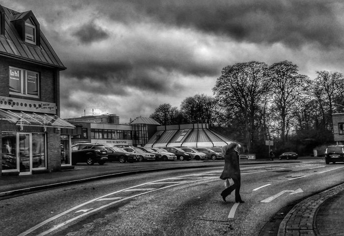 Bad Weather Bad Weather On Its Way Dezember 2016 Cloud - Sky Building Exterior Architecture City One Person Outdoors Streetphotography Street Photography People Close-up Taking Photos Moments Streetphoto_bw From My Point Of View Eyeemphotography Check This Out Still Life Photography Hello World Architecture Go EyeEm Best Shots - Black + White