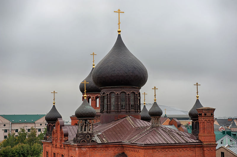 High Section Of Cathedral Against Cloudy Sky