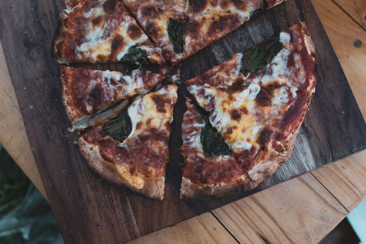High angle view of pizza on cutting board