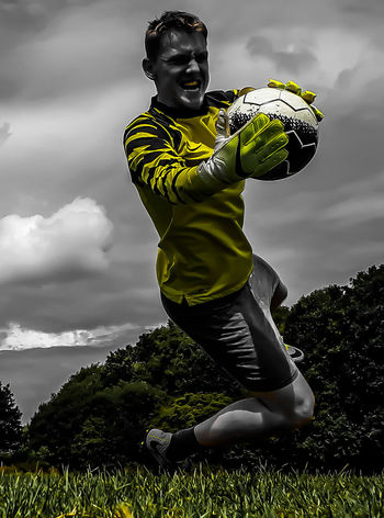 Healthy Lifestyle Cloud - Sky Sports Clothing Athlete One Person Sport Exercising Adults Only Soccer Sky One Man Only People Adult Young Adult Activity Soccer Player One Young Man Only Standing Only Men Sportsman Goalkeeper Goalkeepers
