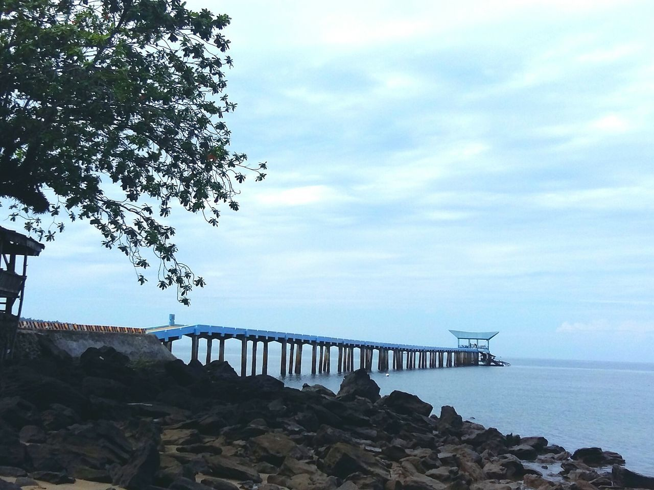 sea, water, sky, nature, scenics, horizon over water, beauty in nature, outdoors, bridge - man made structure, no people, day, tranquil scene, built structure, cloud - sky, tranquility, tree, architecture