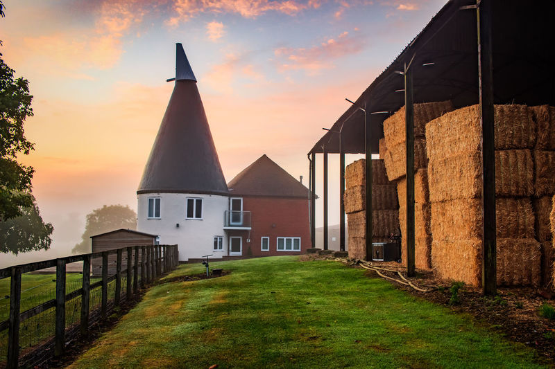 Oast House,Garden of England, Kent, England. Plant Nature No People Built Structure Architecture Building Exterior Outdoors Building Hops Beer Brewing Travel Destinations Tourism Caravan Rural Scene Countryside EyeEm Gallery Vivid International Getty Images Architecture Iconic Buildings Sky Grass Place Of Worship Sunset Orange Color Religion House Cloud - Sky Spirituality Belief