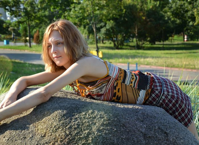 Adult Adults Only Arts Culture And Entertainment Beautiful Woman Beauty Beauty In Nature Day Girl On A Rock Leisure Activity Music Nature One Person One Woman Only One Young Woman Only Only Women Outdoors People Pure Girl Pure Girl On A Rock Purity Rock Side View Sitting Young Adult Young Women