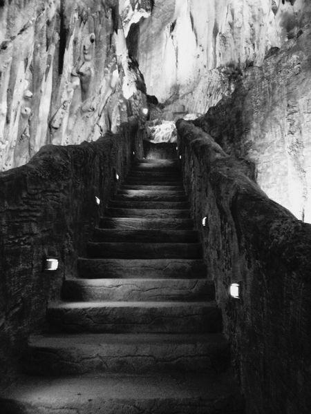Stairs inside Batu Caves, Malaysia. · Cave Underground Dim Light Blackandwhite Monochrome