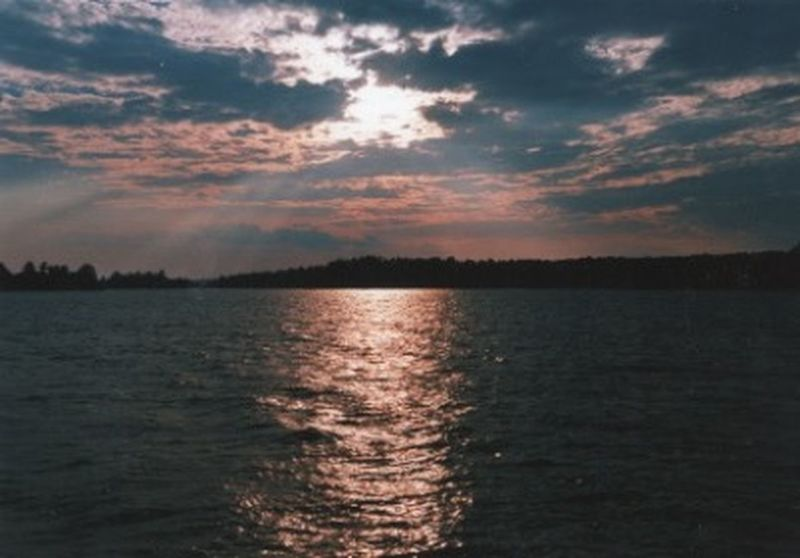 Headed home Cloud - Sky Distant Lands Far From Home Lake Reflection Sun Rays Sunset Tranquil Scene