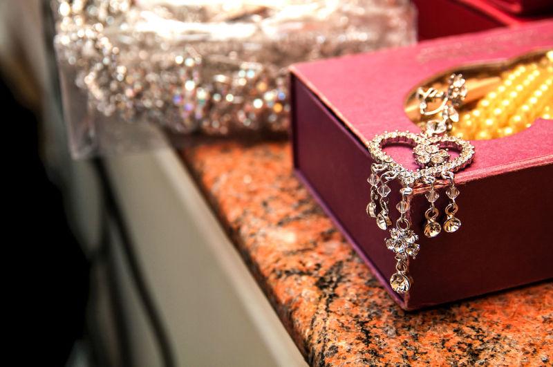 Close-Up Of Jewelry On Box