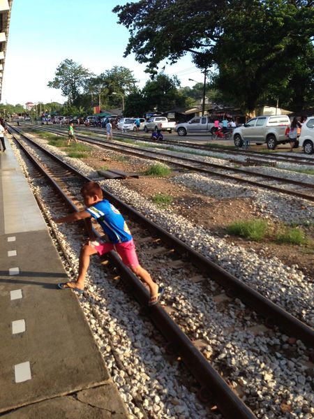 Railway Child. Trang Thailand Child Railway Tracks Railway Crossing Train Station Step Stepping Up Train Tracks Sunny Day Spotted In Thailand