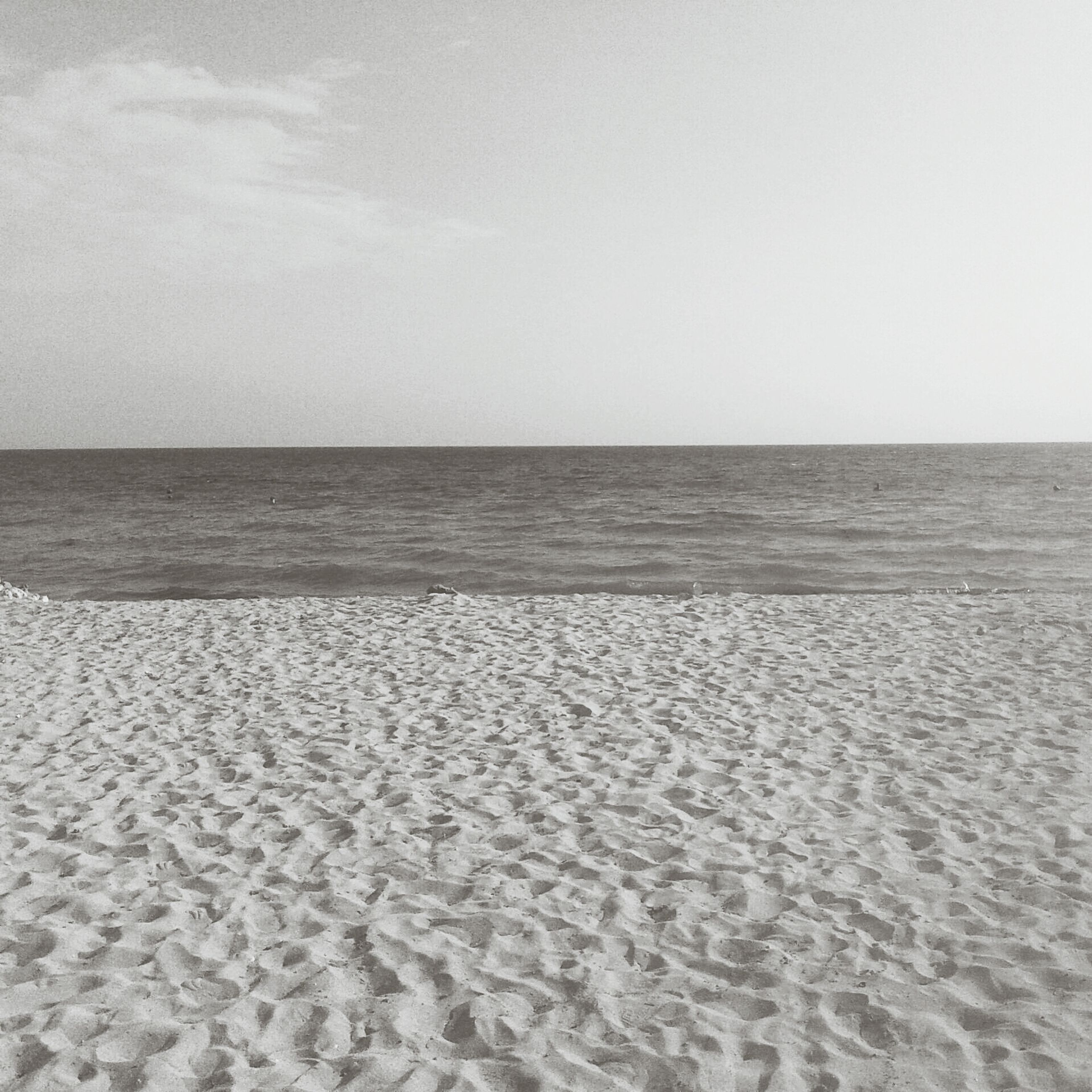 sea, horizon over water, tranquil scene, beach, tranquility, scenics, beauty in nature, sand, water, nature, sky, copy space, shore, clear sky, idyllic, remote, day, seascape, outdoors, no people