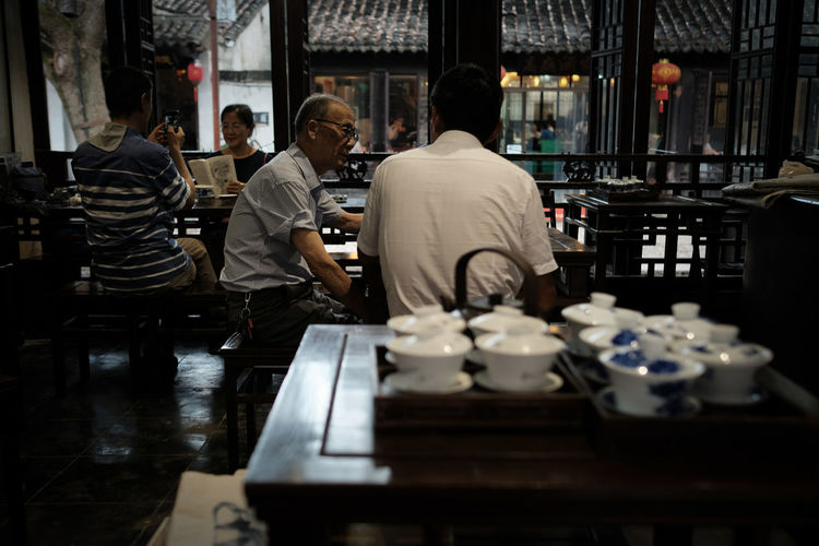 Chinese tearoom, Xitang, Zhejiang, China. FUJIFILM X-T2 Shanghai Adult Architecture Business China Cup Food And Drink Fujifilm Group Incidental People Indoors  Lifestyles Men Occupation People Real People Restaurant Selective Focus Table Tearoom