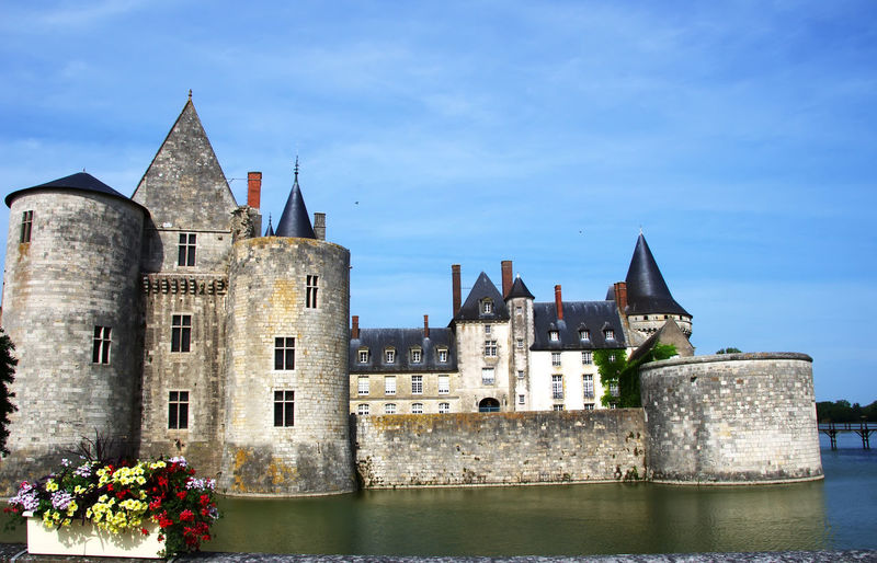 medieval castle Sully-sul-Loire. famous Loire valley river, France Sully-sul-Loire Architecture Building Exterior Built Structure Castle Castle Sully-sul-Loire Flower History Medieval Castle No People Outdoors Sky Tower Travel Destinations Water Waterfront