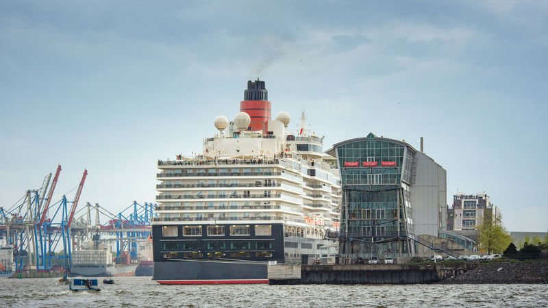Container Container Ship Cruise Ship Dockland Architecture Building Exterior Built Structure City Cruise Day Elbe Nature No People Outdoors Sea Sky Terminal Travel Destinations Vessel