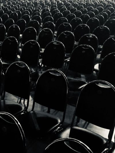 Rear view of people in empty chairs