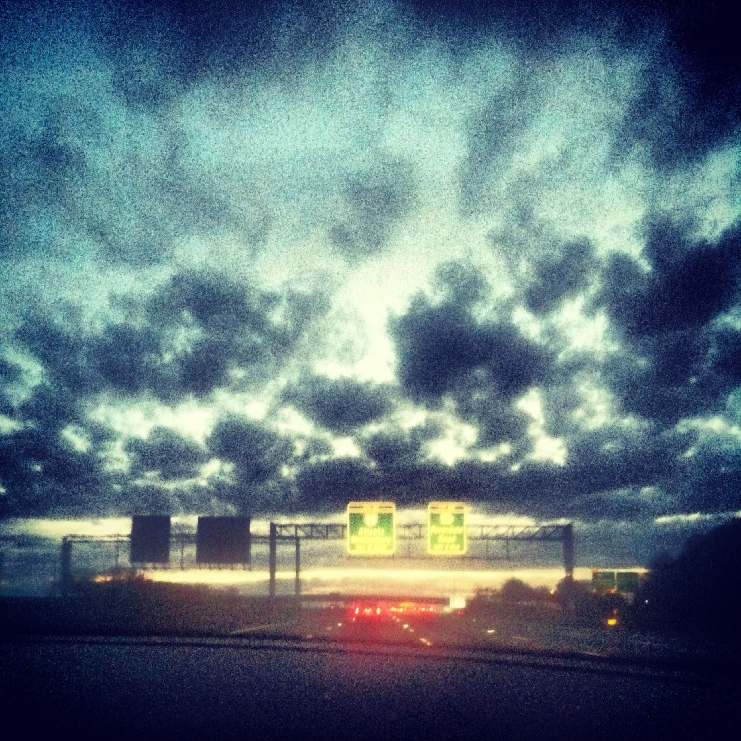 sky, cloud - sky, transportation, road, cloudy, text, western script, weather, communication, guidance, dusk, road marking, cloud, road sign, street, sunset, sign, nature, overcast, dramatic sky
