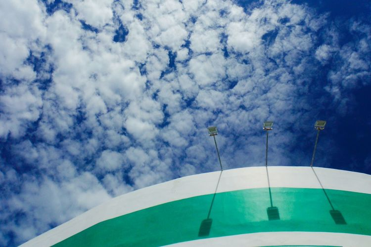 The big blue Sky And Clouds Minimalism Blue Sky Blue Sky And Clouds Blue Sky White Clouds Minimalobsession Minimalist Background Open Open Sky Building Exterior Buildings & Sky Building And Sky Bright Colors Lamp Post Looking Up Looking Up At The Sky Looking Up At Buildings Clouds And Sky Cloudporn Cloudscape Skyporn White Clouds Simple Bright Day
