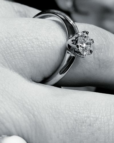 Human Hand Human Finger Diamond Ring Adults Only Only Women One Woman Only Close-up Human Body Part Women Wedding Ring Jewelry People Real People Lifestyles Platinum Diamond Rings Diamond Tranquility Blackandwhite Black And White Black And White Photography One Person Ring Blackandwhitephotography Investing In Quality Of Life
