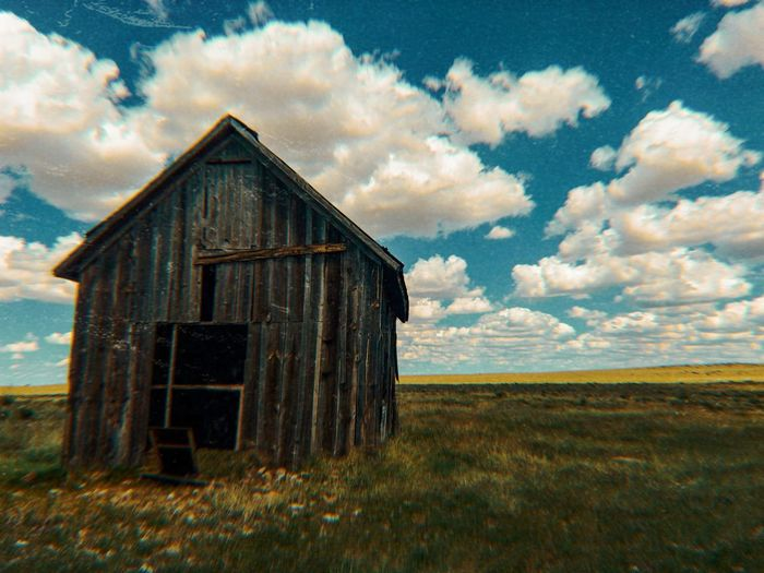 """""""Frozen In Time"""" An old barn stands against the ravages of time, framed by seemingly endless clouds, on the open grassland of Central New Mexico. Vintage New Mexico Skies Landscape Grassland Old Barn Barn Clouds And Sky Scenics Clouds Cloudscape New Mexico New Mexico Photography Rural Scene No People Building"""