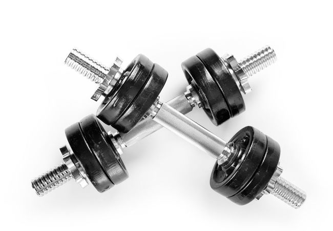 Crossed chrome hand barbells weights black color on white background in horizontal orientation, nobody. Barbell Barbells Crossed Dumbbell Dumbbells Equipment Exercise Fitness Gym Heavy Iron Metal No People Nobody Sport Steel Weight Weights