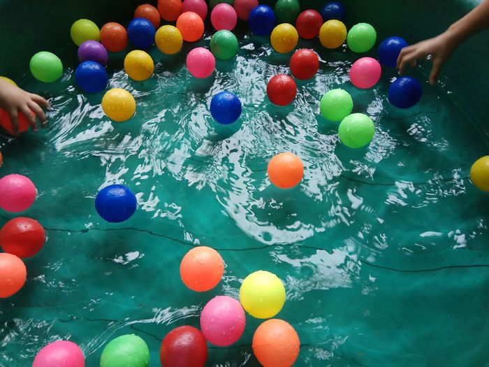 Kiddie Pool Colored Balls Water Pool Bright Bright Colors Human Hand Multi Colored Easter Variation Celebration Close-up Sweet Food