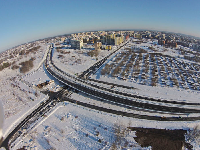 New Road  New Roads Winter Snow Snow ❄ Snow❄⛄ Drone  Droneshot High Angle View City Aerial View Travel Cityscape Travel Destinations Architecture Tourism Outdoors Traffic Circle Concentric Skyscraper Water Sky No People Day Vilnius