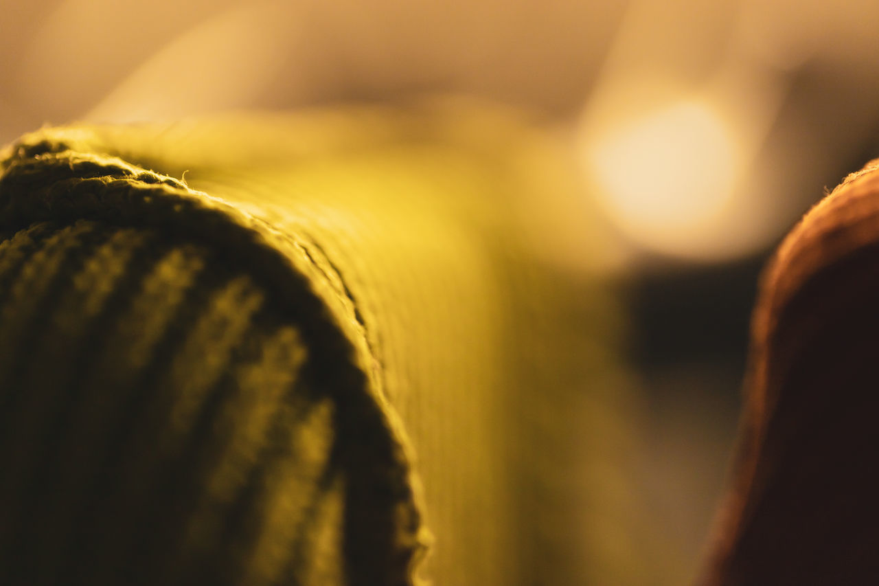 close-up, selective focus, indoors, no people, yellow, textile, backgrounds, full frame, clothing, cozy, extreme close-up, softness, comfortable, material, textured, pattern, brown, day, detail