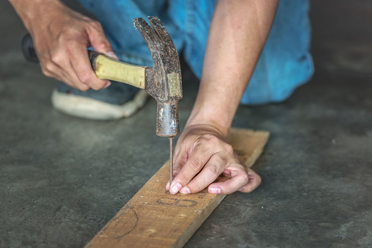 man hands drive nail with a hammer in wooden Close-up Craftsperson Day Focus On Foreground Holding Human Body Part Human Hand Low Section Men Occupation One Person Outdoors Real People Skill  Wood - Material Work Tool Working Workshop