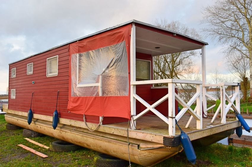 Linumer Hafen Red Bare Tree Cloud - Sky Day Grass Houseboat Linum No People Outdoors Sky Tree