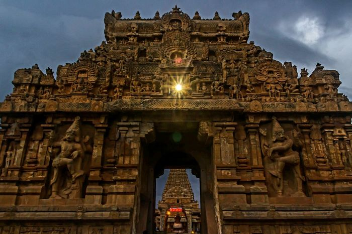 I was not allowed to take my tripod inside the temple..had to bump up my ISO and i'm extremely sorry for the bad pic quality🙏 Architecture Travel Destinations Gate Tourism History Ancient Civilization Sky Sculpture Built Structure Rain Clouds Day Temple Entrance Temple Architecture Tanjore_big_temple Chola Architect UNESCO World Heritage Site The Architect - 2017 EyeEm Awards