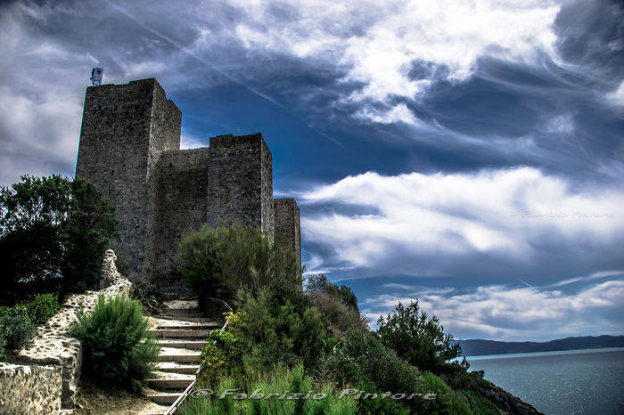 Roca di Talamone Ancient Civilization Architecture Beauty In Nature Building Exterior Built Structure Castle Cloud - Sky Day History Mountain Nature No People Old Ruin Outdoors Sky The Past Tranquility Tree Water Lost In The Landscape