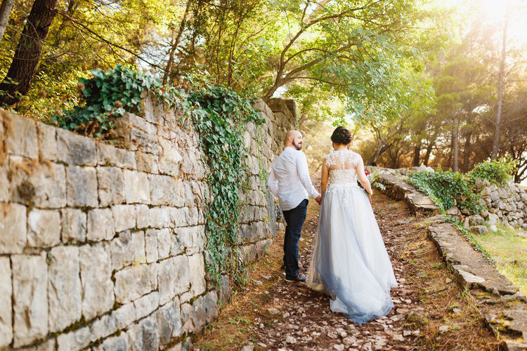 Rear view of couple walking in park