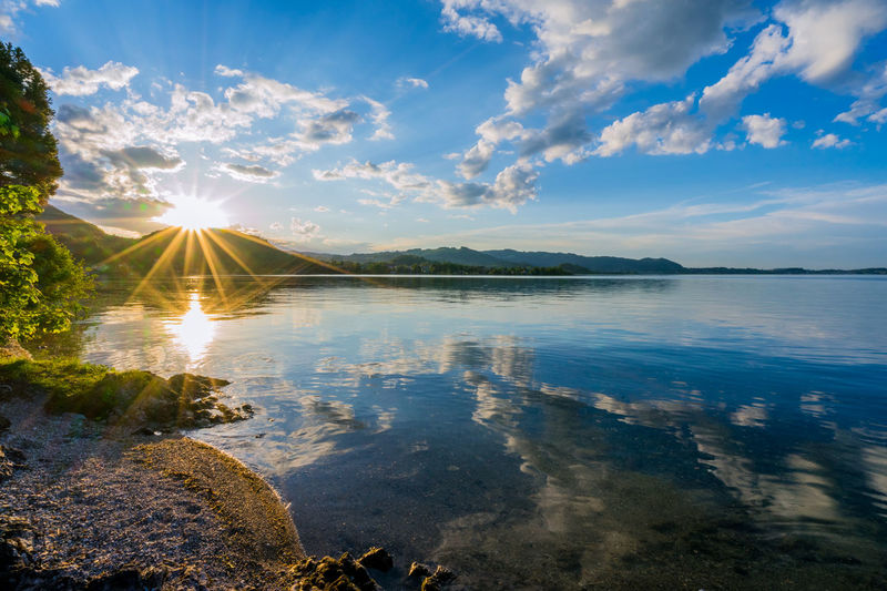 Austria EyeEm Nature Lover Sunset_collection Beauty In Nature Cloud - Sky Day Idyllic Lake Landscape Lens Flare Nature Non-urban Scene Outdoors Reflection Scenics - Nature Sky Sun Sunbeam Sunlight Sunset Tranquil Scene Tranquility Traunkirchen Traunsee Water