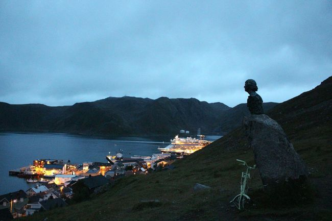 the rock. Honningsvag Prestvatnet Norway Illuminated Outdoors No People Statue Bicycle Nature Rocks Mountain Water Oceanview Cityview Cruiseship Landscape Hills Hiking Summernight