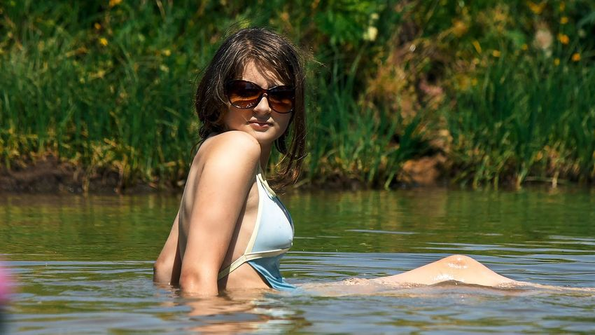 Russia Bikini Water Beauty Summer Nature Vacations One Person Adult Lake Sunglasses Outdoors One Woman Only Travel Only Women Women Lifestyles Swimming Young Adult Reflection Relaxation