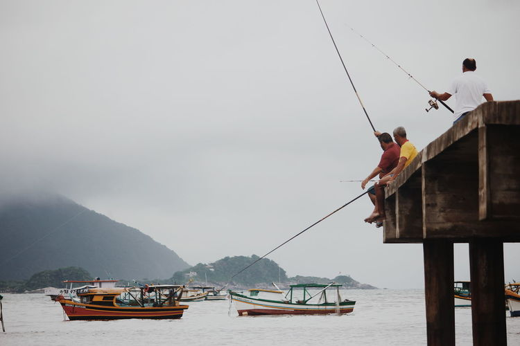 Brazil Guarujá Architecture Beach Beauty In Nature Day Fisherman Fishing Industry Fog Men Mode Of Transportation Mountain Nature Nautical Vessel Occupation Outdoors Real People Scenics - Nature Sea Sky Transportation Travel Water Waterfront