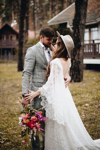 Couple walking in park. Wedding Wedding Love Two People Couple - Relationship Newlywed Bride Event Celebration Wedding Dress Married Adult Togetherness Emotion Life Events Young Adult Women Young Men Positive Emotion Men Flower Husband Young Couple Flower Arrangement Bouquet Wife