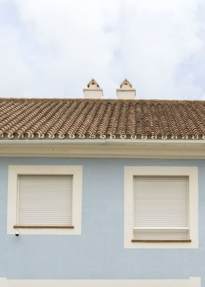 SPAIN Architecture Colours Minimalism Minimalist Architecture Building Exterior Built Structure Building Window Residential District Day No People Outdoors Cloud - Sky Roof Low Angle View Sky House City Roof Tile Animal Themes Wall - Building Feature Window Frame Ornate Security Camera