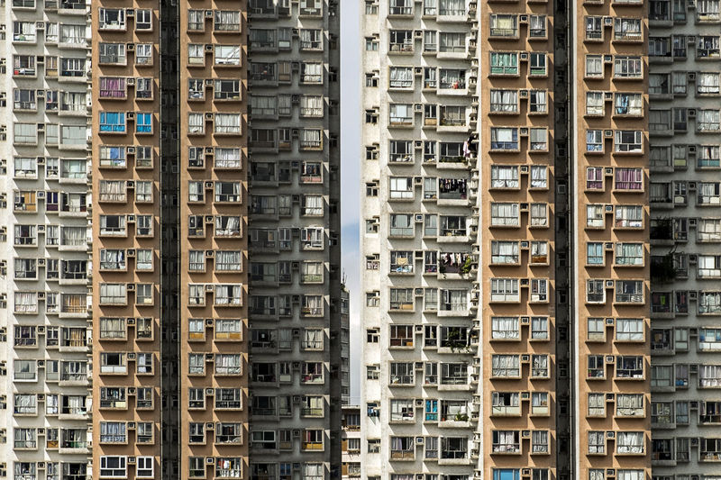 Jam-Pack Hong Kong Accommodation Tower Block  Abundance Air Conditioner Apartment Architecture Backgrounds Balcony Building Building Exterior Built Structure City Day Density Living Full Frame Hong Kong Living Culture In A Row Low Angle View No People Outdoors Pattern Repetition Residential District Sardine Apartment Window