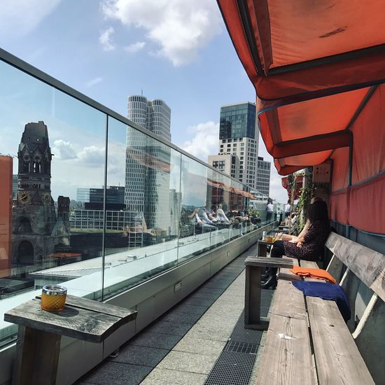 View from the Monkey Bar, Berlin Architecture Backgrounds Bridge - Man Made Structure Building Building Exterior Built Structure City City Life Cityscape Cloud - Sky Connection Day Leisure Activity Lifestyles Men One Person Outdoors People Real People Rooftop Rooftopbar Sitting Sky Women