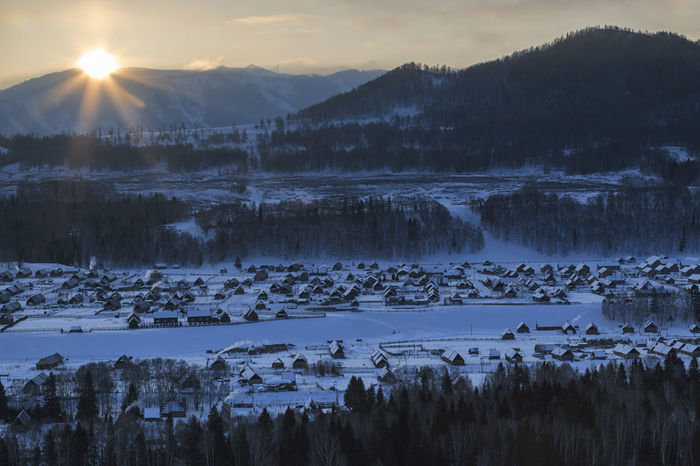 Hemu village at sunrise in Xinjiang, China, Kanas ASIA Altai Mountains Bactrian Camel Ice Kanas Lake Urumqi XinJiang Altai China Grassland Hasake Minority Hemu Village Horse Racing Kanas Ski Country Snow Tuva Minority