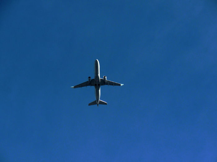 Low angle view of airplane flying in clear sky