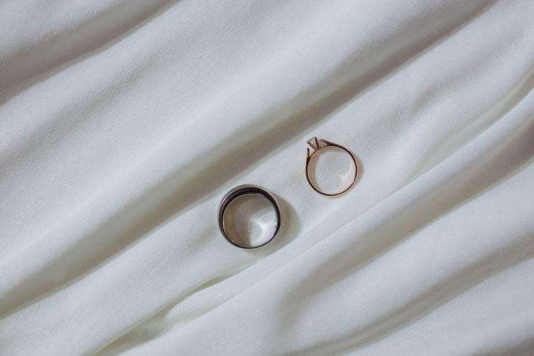 High angle view of wedding rings on metal