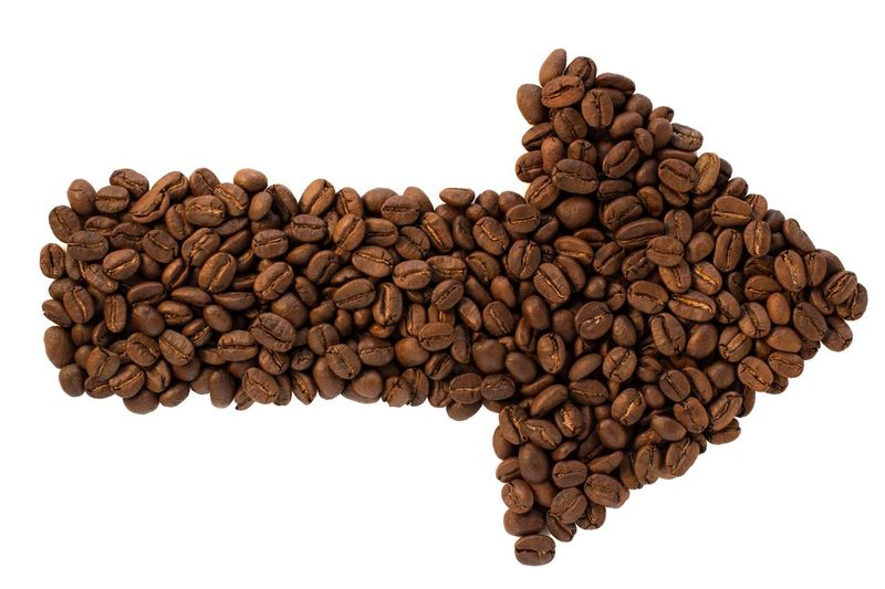 coffee beans arrow shape Direction Destination Coffee Shop Marker Guide Location Cursor Indicator Pointer Coffee Coffee Bean Arrow Symbol Arrow Sign Roasted Coffee Bean Copy Space White Background Brown Food Creativity Pattern Close-up Shape Design Textured