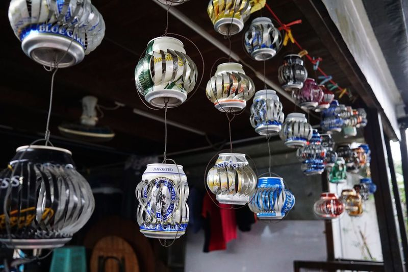 Close-up of lanterns hanging in market for sale
