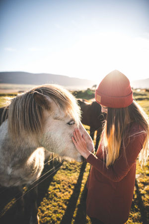 One Animal Animal Themes One Person Adults Only Touching Domestic Animals People Adult Sunlight Animal Day Happiness Outdoors Iceland Dreamy Idyllic Showcase: April Europe Travel Full Frame Travel Destinations Travel Photography Nature Horse