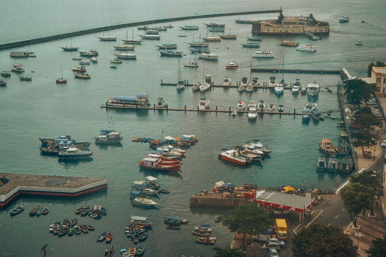 Aerial view of boats sailing at harbor