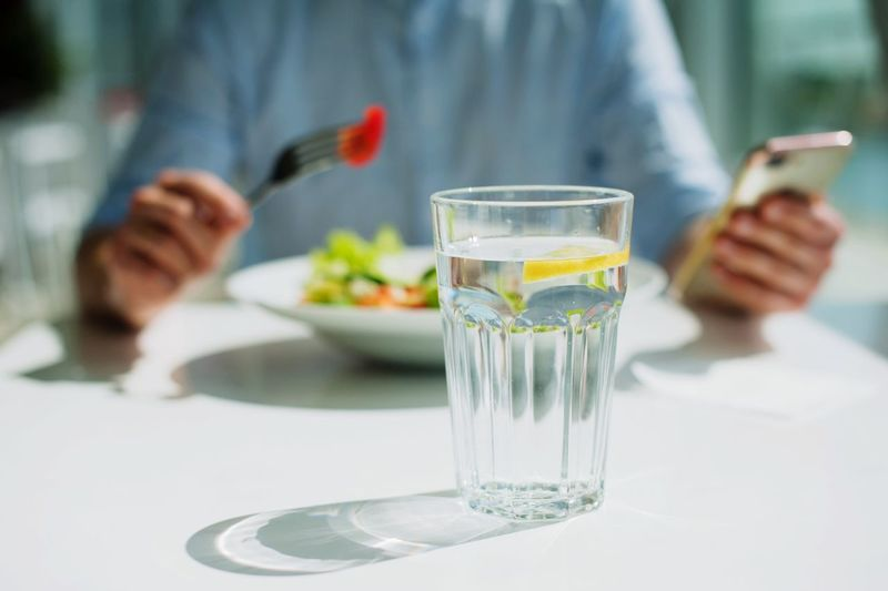 young guy eating a salad One Person Table Glass Food And Drink Hand Human Hand Focus On Foreground Refreshment Holding Freshness Plate Real People Indoors  Lifestyles Drink Midsection Drinking Glass Household Equipment Adult