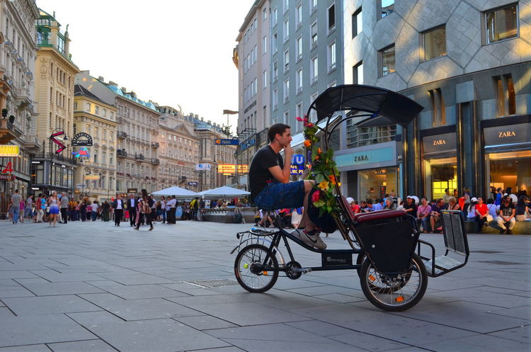 Stepnansplatz. Architecture Bicycle Bicycle Taxi Buildings Candid City City Life City Street Colorful Colors Documentary Europe Innerestadt Lifestyles People Person Sight Sight Seeing Stephansplatz, Vienna Street Photography Taxi Tourism Travel Travel Photography Vienna