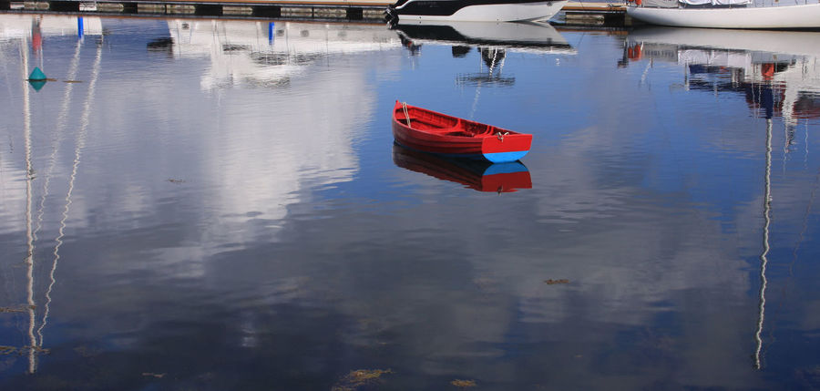 Boats Day Moored Nautical Vessel No People Outdoors Red Reflection Rowing Boat On Water Scotland Tarbert Water Waterfront