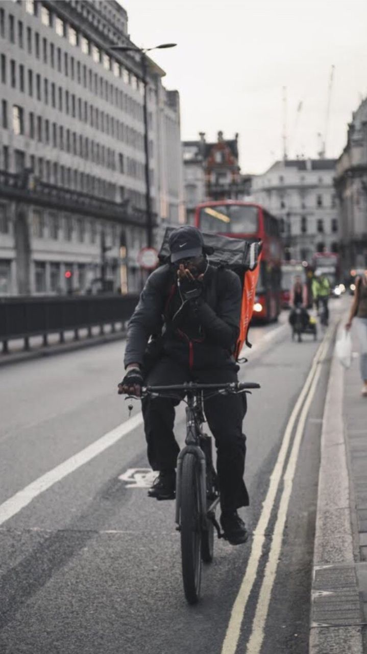 MAN RIDING BICYCLES ON ROAD