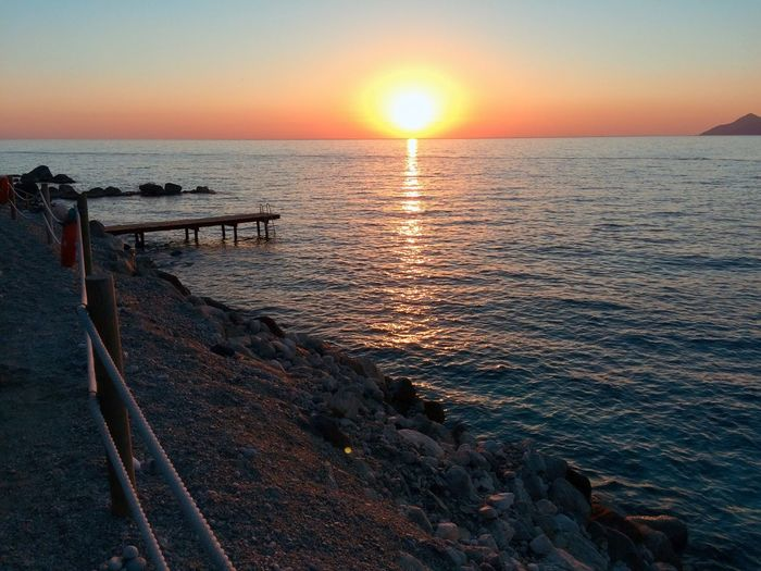 Sunset Sea Sun Scenics Beauty In Nature Water Nature No People Clear Sky Sunlight Horizon Over Water Beach Orange Color