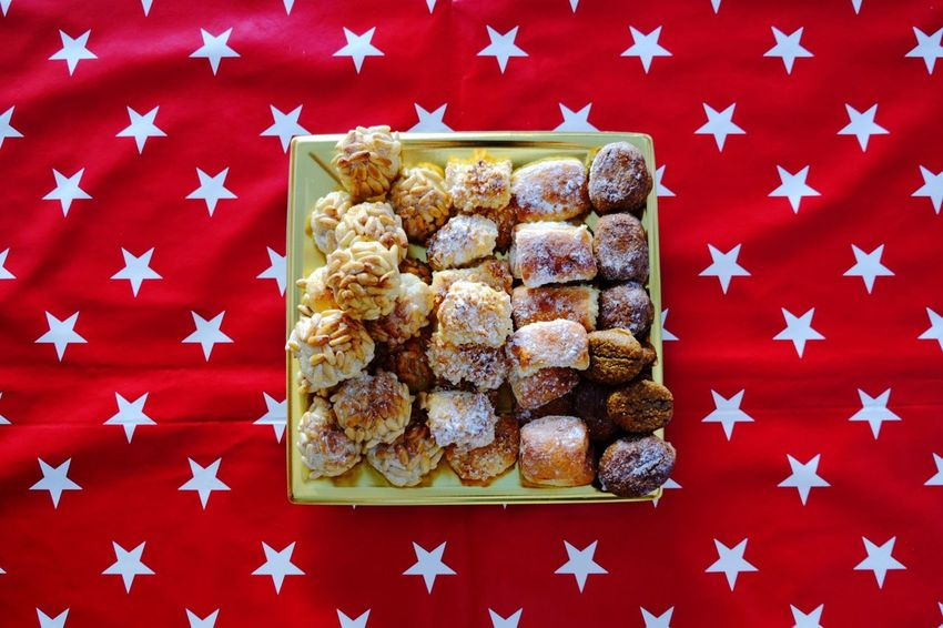 These days... Panellets! // Star Shape Patriotism Flag No People Indoors  Food And Drink Celebration Sweet Food Food Raisin Blue Studio Shot Close-up Baking Pan Ready-to-eat Freshness Day Fujifilm_xseries Catalunya Catalonia Panellets Cooking The Week On EyeEm Red Red Color